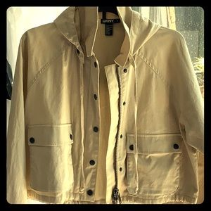 Beige DKNY jacket with removable hood.